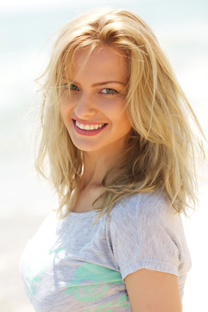 summer beauty: Sunny portrait of a cute attractive beautiful smiling blondie girl woman