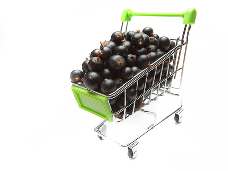 Blackcurrant in a shhopping cart isolated on white background