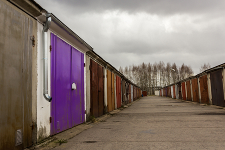 Garage Community Perspective On A Cloudy Day With Purple Red Brown Doors