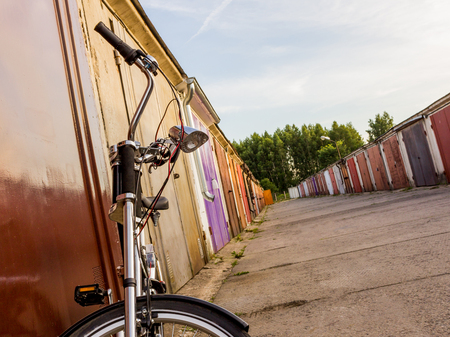 Custom tuned bicycle eco chopper style in a garage community on a golden sunny day