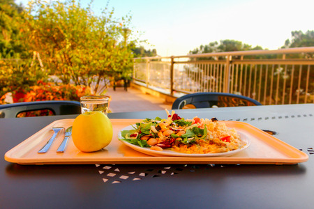 Mediterranean lunch or dinner on a warm sunny day in an outdoors restaurant