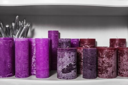 purple candles on a shelf. home decor
