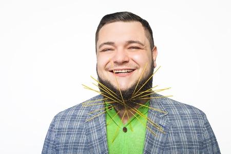 caterers: fat bearded man stuck in his beard spaghetti Stock Photo