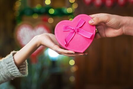 man gives girl gift on Valentines Day Stock Photo