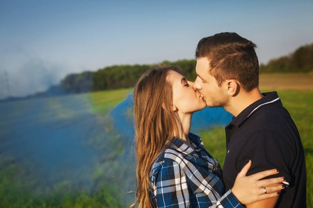 tenderly: Young affectionate couple kissing tenderly