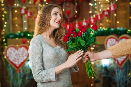 guy present girl flowers on Valentines Day Stock Photo
