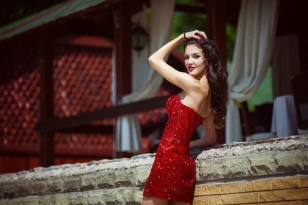 Young beautiful and passionate woman in short red dress