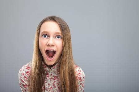 Cute caucasian blonde teen screams Stock Photo