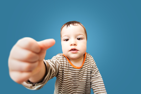 prank: little baby with big brown eyes Stock Photo