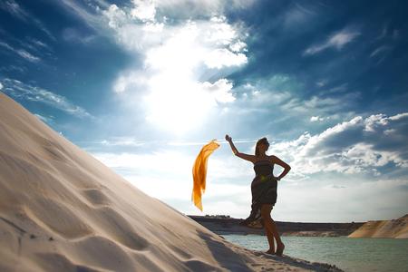 enchanting: girl in desert near oasis