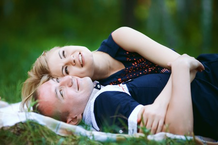 sweet lovers lying on grass Stock Photo
