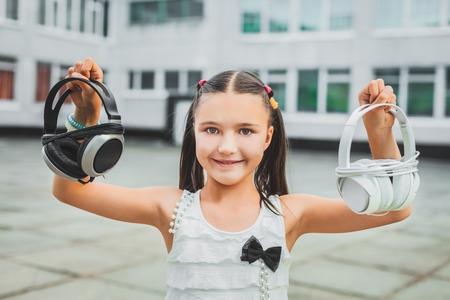 Little girl holding headphone