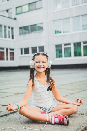 nice girl sitting and listening music with headphones