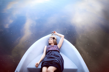 luxurious: beautiful girl laying on the boat Stock Photo
