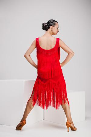 girl in red dress turning backwards