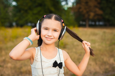 soundtrack: pretty girl with long hair listening song Stock Photo