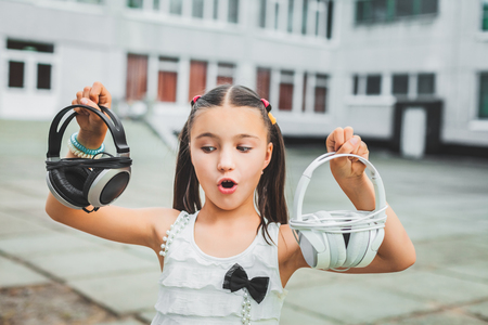 beautiful girl holding headphone