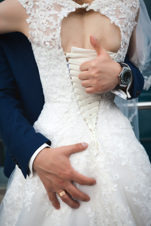 Groom showing a gesture thumb up Standard-Bild