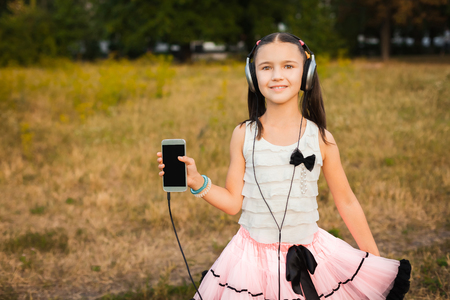 soundtrack: little girl showing her mobile telephone and smiling