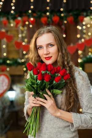 pretty girl in love celebrate valentines day. girl smiling and enjoy flowers from her boy