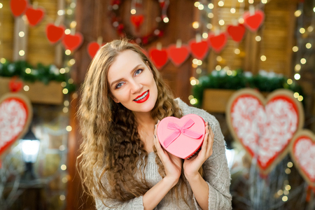 beautiful teen in love celebrate valentines day. girl smiling and enjoy present