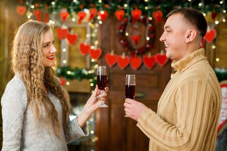 boy and girl celebrate valentines day. they hugging, smiling and drinking champagne. Concept of happy valentines day