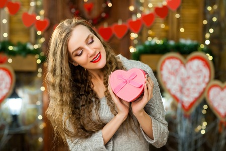 beautiful woman in love celebrate valentines day. girl smiling and enjoy present
