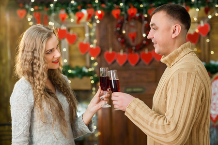man and woman celebrate valentines day. they hugging, smiling and drinking champagne. Concept of happy valentines day
