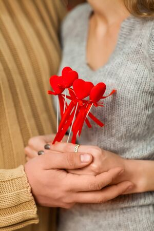 Close up shot boy and girl holding hearts in hands on valentines day. Stock Photo