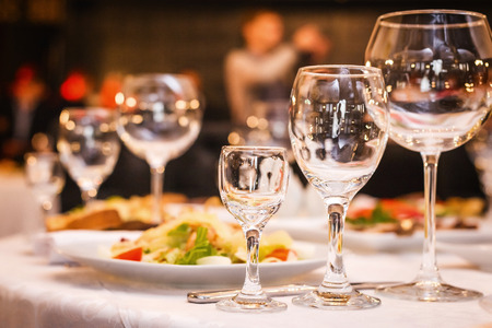 fancy wedding goblets glasses laying on the table with foods at the wedding banquet. concept of wedding decorum