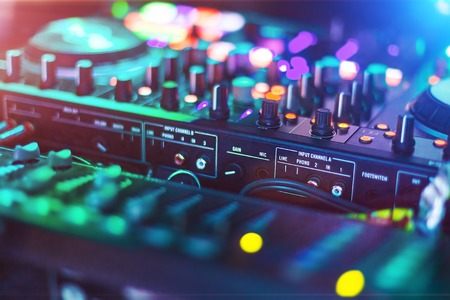 Audio mixer Control Panel in a night club. DJ professional sound technology. Buttons and tabs of the audio controller for disk jockey