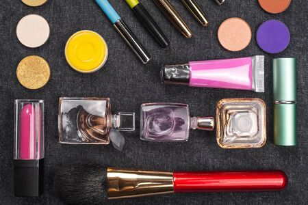 composition of variegated decorative cosmetics including lipstick eye pencil, powder and mascara. concept of professional makeup Stok Fotoğraf