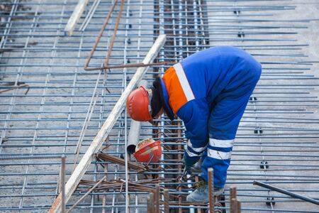 fixer: Construction Worker connects rebar at a construction site