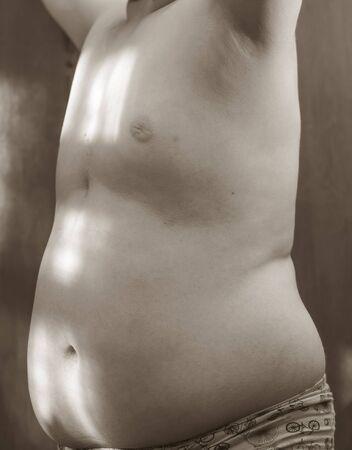 obesidad infantil: la obesidad de la ni�ez ni�o de 12 a�os, el cuerpo del est�mago. enfermedad trastorno metab�lico Foto de archivo