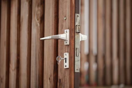 key in the lock of the wooden door Stock Photo