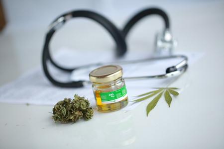 cannabis, CBD oil ,stethoscope and recipe Foto de archivo