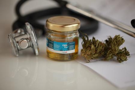 cannabis, CBD oil ,stethoscope and recipe Standard-Bild