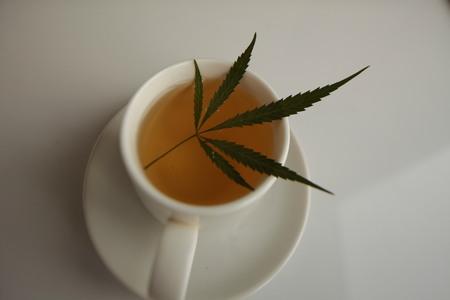 cannabis tea white cup