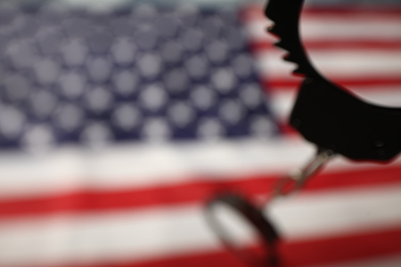 handcuffs on the background of the US flag Reklamní fotografie
