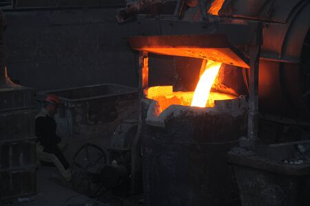 Belarus, Minsk, 2014. Work in the foundry. molten metal worker at a metallurgical plant