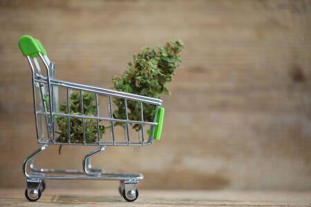 Marijuana medical cannabis cbd in mini shopping cart toy Stok Fotoğraf