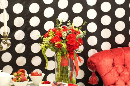 Festive table decoration with flowers at a wedding exhibition
