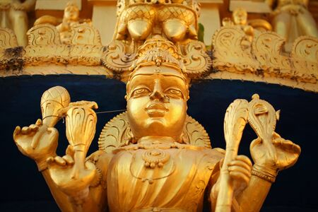 bright figures of the gods on the gopurama of a hindu temple in sri lanka 免版税图像