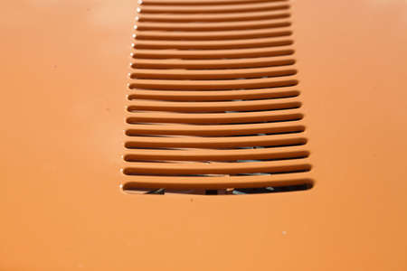 air intake grille on the body of a retro car