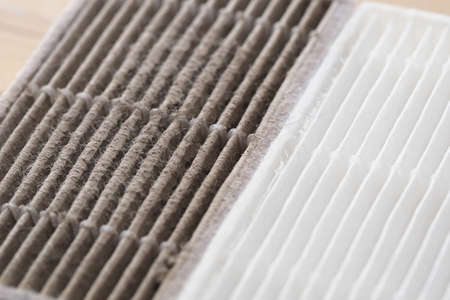 new and dirty air filter for robot vacuum cleaner Foto de archivo