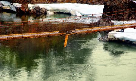 rope bridge: broken rope bridge across the river
