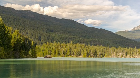 Green lake and mountains near Whistler Canada Stock Photo