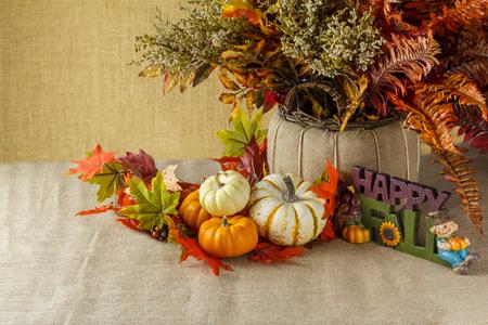 sackcloth: Autumn setup of pumpkins with fall leaves on sackcloth