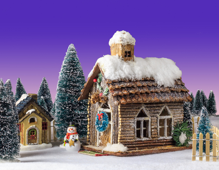 next year: New Year Christmas house decorated with snow figure snowman next to wooden house. Stock Photo