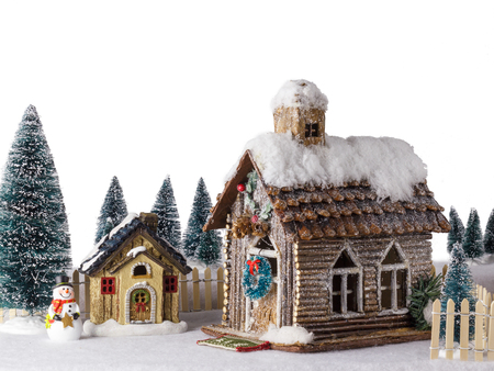 next year: Isolated New Year Christmas house decorated with snow figure snowman next to wooden house.
